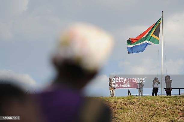 Theo of Mafikizolo raises the South African flag during the Action 2015 Global mobilization event on September 24 2015 in Johannesburg South Africa...