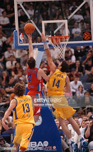 Theo Papaloukas of CSKA Moscow gets past Yaniv Green of Macabbi Tel Aviv on the way to the basket during the NBA Europe Live Tour presented by EA...