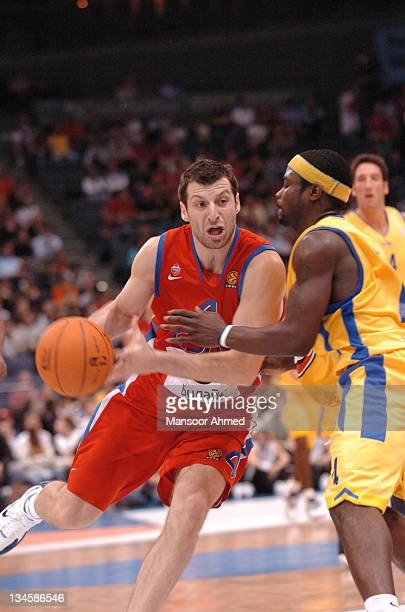 Theo Papaloukas of CSKA Moscow tries to get past Will Bynum of Macabbi Tel Aviv during the NBA Europe Live Tour presented by EA Sports on October 10...