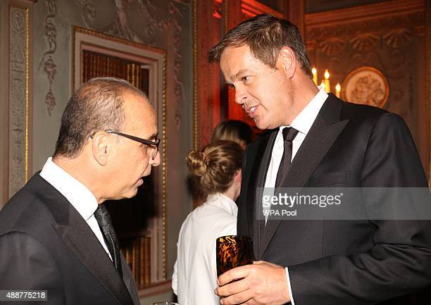 Theo Paphitis and Peter Jones chat during during the Tusk Trust conservation charity 25th Anniversary Ball which honours the charity's impact in the...