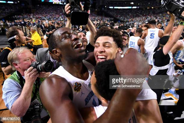 Theo Pinson and Justin Jackson of the North Carolina Tar Heels embrace after time expires during the 2017 NCAA Men's Final Four National Championship...