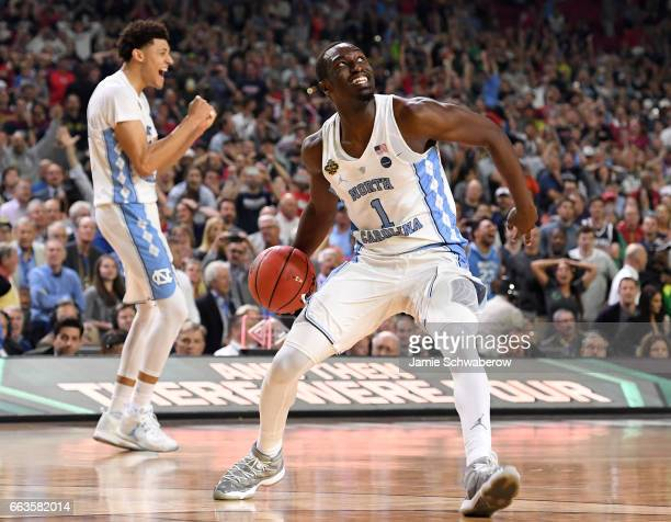 Theo Pinson and Justin Jackson of the North Carolina Tar Heels celebrate as time expires during the 2017 NCAA Photos via Getty Images Men's Final...
