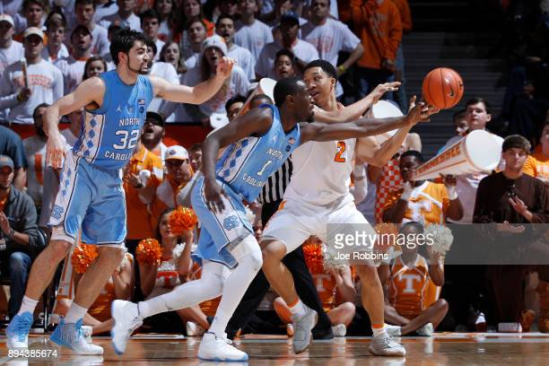 Theo Pinson and Luke Maye of the North Carolina Tar Heels defend against Grant Williams of the Tennessee Volunteers in the second half of a game at...