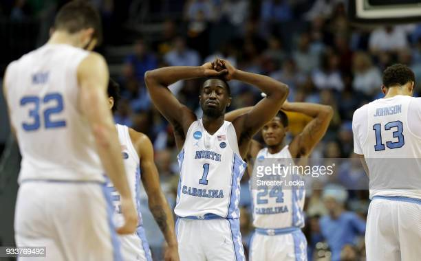 Theo Pinson and teammate Kenny Williams of the North Carolina Tar Heels react at the end of their game against the Texas AM Aggies during the second...