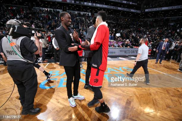 Theo Pinson of the Brooklyn Nets talks with Danny Green of the Toronto Raptors a/tg/ on April 3 2019 at Barclays Center in New York City New York...