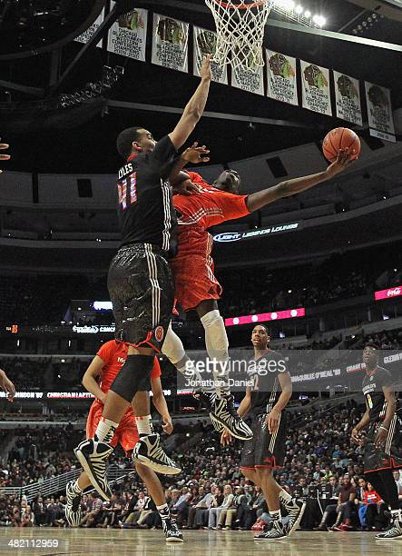 Theo Pinson of the East team shoots against Trey Lyles of the West team during the 2014 McDonald's All American Game at United Center on April 2 2014...