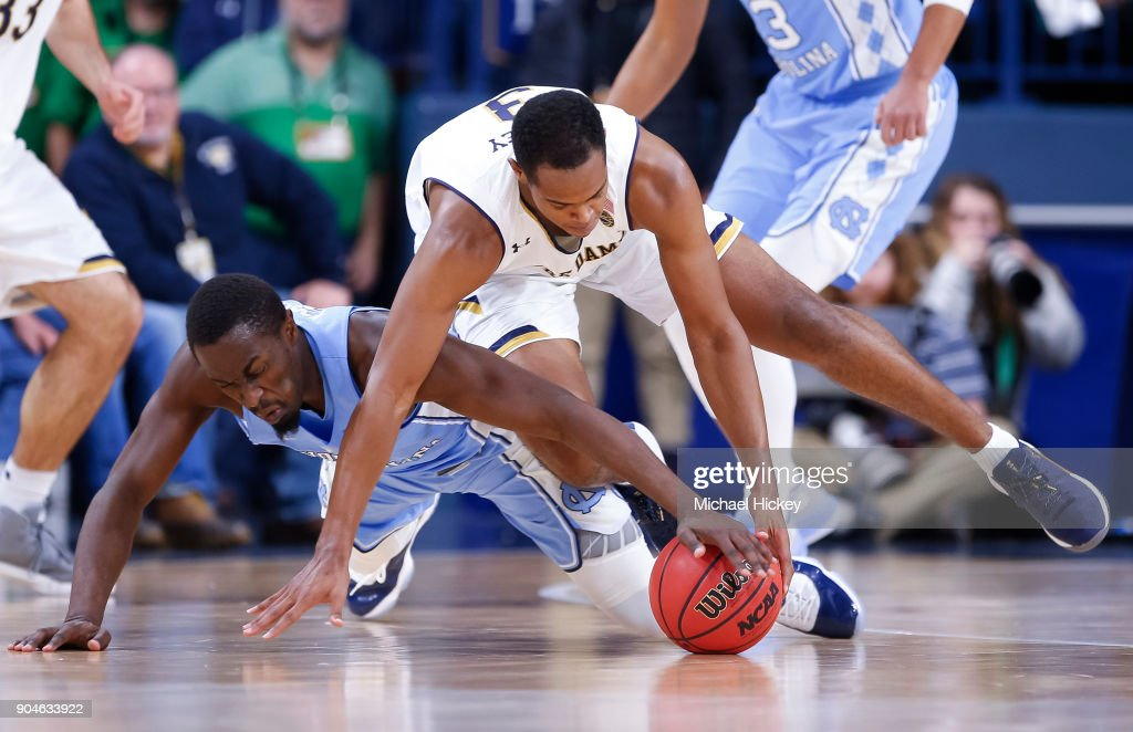 Theo Pinson #1 of the North Carolina Tar Heels and D.J. Harvey #3 of the Notre Dame Fighting Irish battle for the loose ball at Purcell Pavilion on January 13, 2018 in South Bend, Indiana.