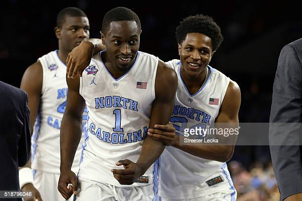 Theo Pinson of the North Carolina Tar Heels and Kenny Williams celebrate defeating the Syracuse Orange 8366 in the NCAA Men's Final Four Semifinal at...