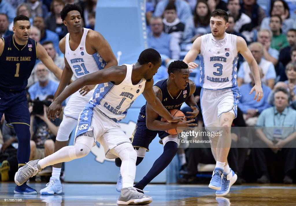 Theo Pinson #1 of the North Carolina Tar Heels battles TJ Gibbs #10 of the Notre Dame Fighting Irish for a loose ball during their game at the Dean Smith Center on February 12, 2018 in Chapel Hill, North Carolina. North Carolina won 83-66.
