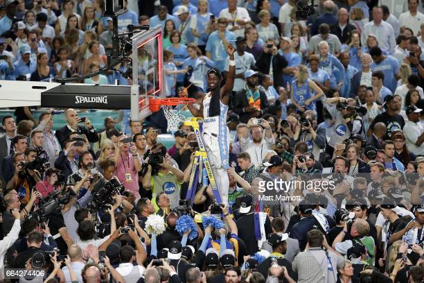 Theo Pinson of the North Carolina Tar Heels cuts a piece of the net during the 2017 NCAA Photos via Getty Images Men's Final Four National...
