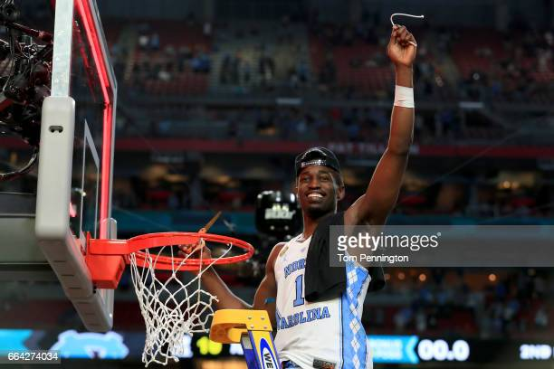 Theo Pinson of the North Carolina Tar Heels cuts down the net after defeating the Gonzaga Bulldogs during the 2017 NCAA Men's Final Four National...