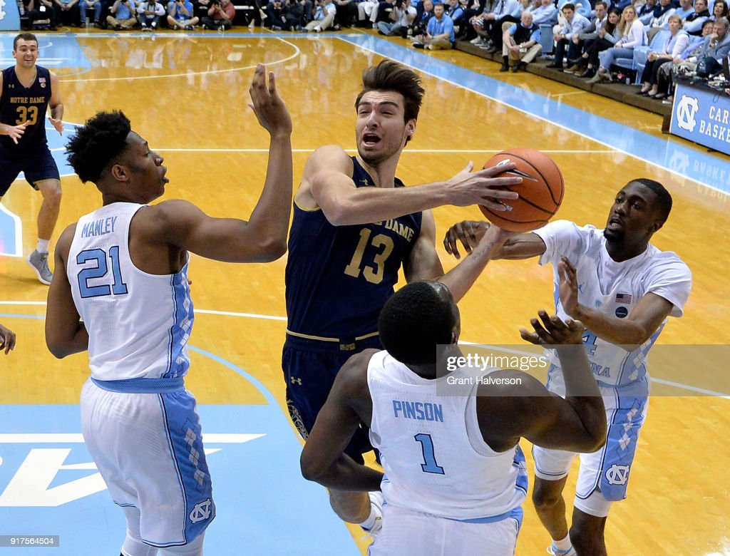 Theo Pinson #1 of the North Carolina Tar Heels defends a drive by Nikola Djogo #13 of the Notre Dame Fighting Irish during their game at the Dean Smith Center on February 12, 2018 in Chapel Hill, North Carolina.