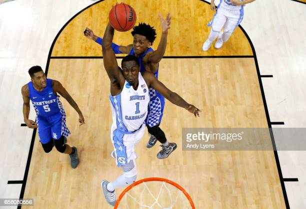 Theo Pinson of the North Carolina Tar Heels drives to the basket against De'Aaron Fox of the Kentucky Wildcats in the second half during the 2017...