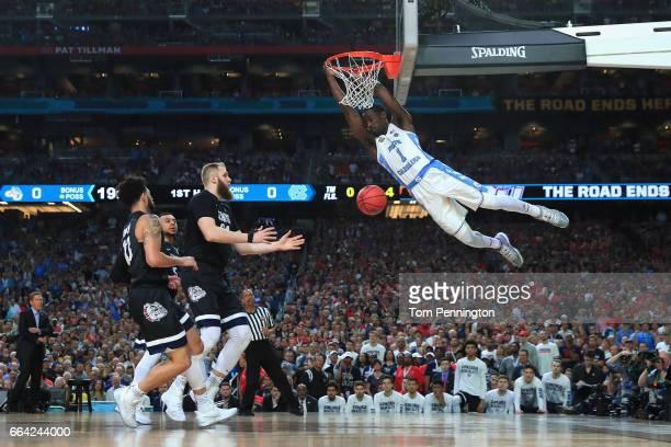 Theo Pinson of the North Carolina Tar Heels dunks in the first half against Przemek Karnowski of the Gonzaga Bulldogs during the 2017 NCAA Men's...