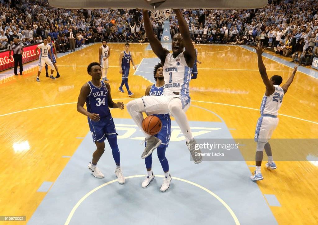 Theo Pinson #1 of the North Carolina Tar Heels dunks the ball as teammates Wendell Carter Jr #34 and Marvin Bagley III #35 of the Duke Blue Devils watch on during their game at Dean Smith Center on February 8, 2018 in Chapel Hill, North Carolina.