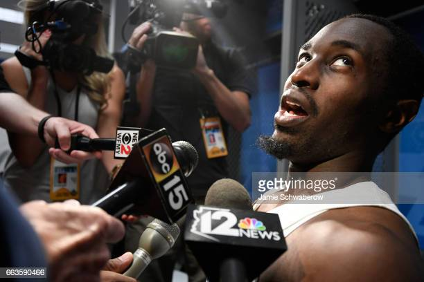 Theo Pinson of the North Carolina Tar Heels gets interviewed in the locker room following the win against the Oregon Ducks during the 2017 NCAA...