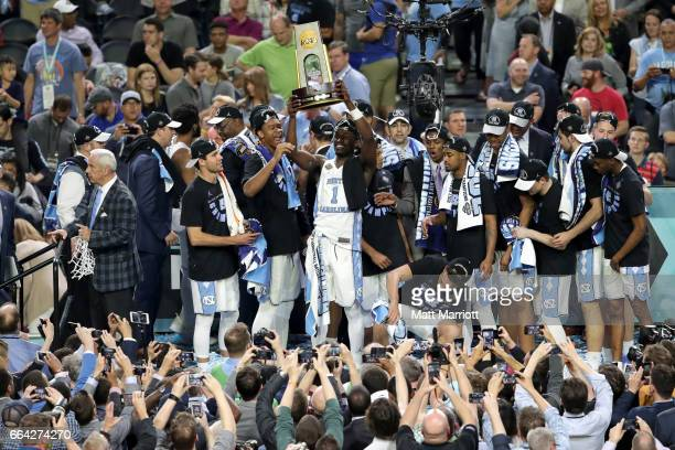 Theo Pinson of the North Carolina Tar Heels hoists the championship trohy with teammates during the 2017 NCAA Photos via Getty Images Men's Final...