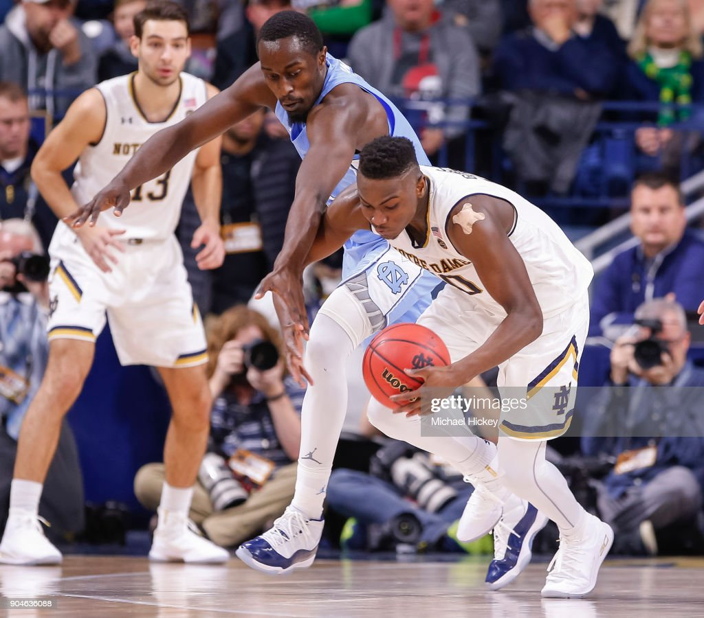 Theo Pinson #1 of the North Carolina Tar Heels reaches for the ball as TJ Gibbs #10 of the Notre Dame Fighting Irish dribbles in the back court at Purcell Pavilion on January 13, 2018 in South Bend, Indiana.