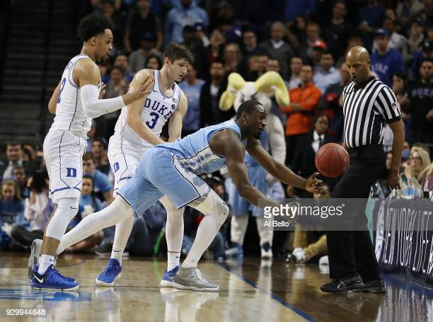 Theo Pinson of the North Carolina Tar Heels reaches for the ball against the Duke Blue Devils during the semifinals of the ACC Men's Basketball...