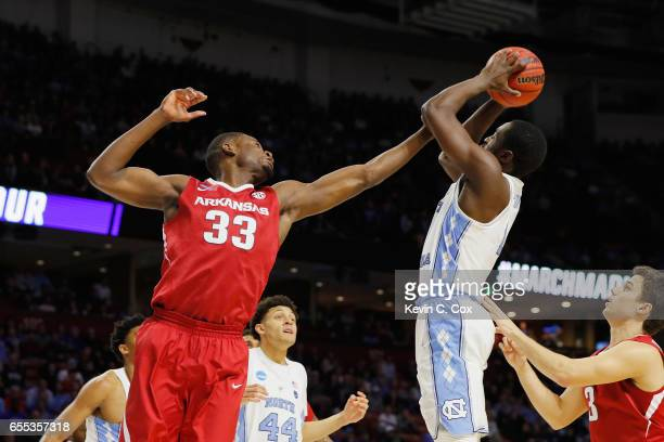 Theo Pinson of the North Carolina Tar Heels rebounds the ball against Moses Kingsley of the Arkansas Razorbacks in the first half during the second...