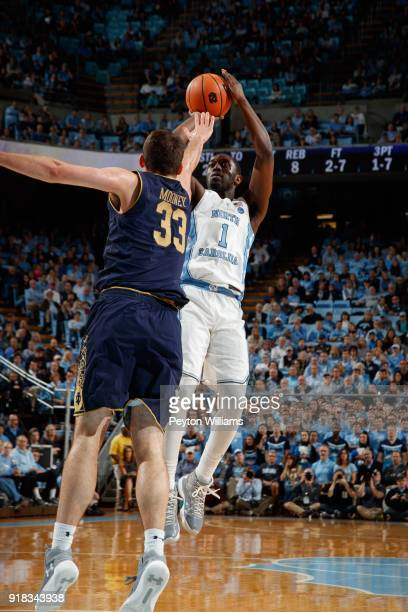 Theo Pinson of the North Carolina Tar Heels shoots over John Mooney of the Notre Dame Fighting Irish on February 12 2018 at the Dean Smith Center in...