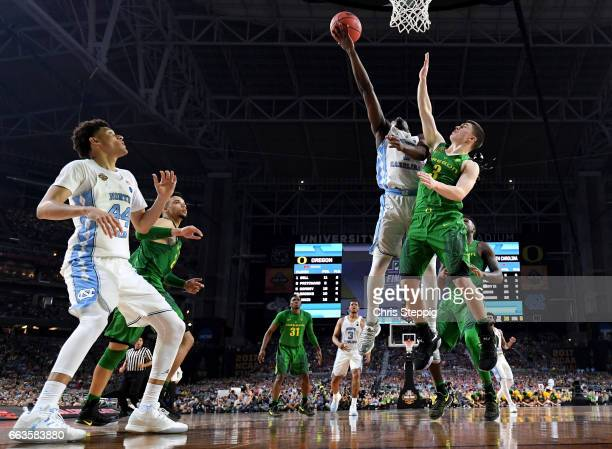 Theo Pinson of the North Carolina Tar Heels shoots the ball over Payton Pritchard of the Oregon Ducks during the 2017 NCAA Photos via Getty Images...