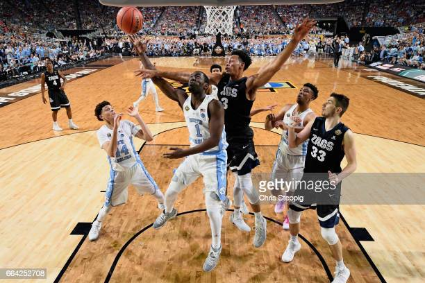Theo Pinson of the North Carolina Tar Heels shoots the ball under Johnathan Williams of the Gonzaga Bulldogs during the 2017 NCAA Photos via Getty...