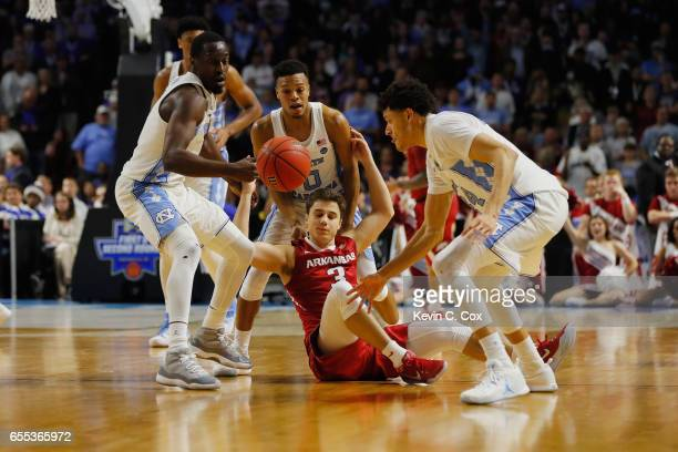 Theo Pinson of the North Carolina Tar Heels steals the ball from Dusty Hannahs of the Arkansas Razorbacks in the second half during the second round...