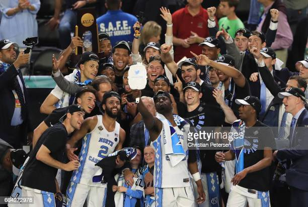 Theo Pinson of the North Carolina Tar Heels takes a selfie with his team after defeating the Gonzaga Bulldogs during the 2017 NCAA Men's Final Four...