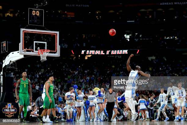 Theo Pinson of the North Carolina Tar Heels throws the ball in the air in celebration after defeating the Oregon Ducks during the 2017 NCAA Men's...