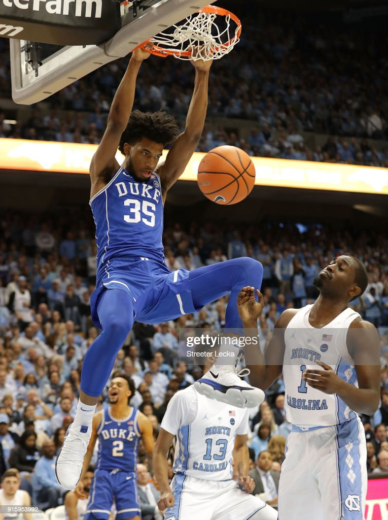 Theo Pinson #1 of the North Carolina Tar Heels watches as Marvin Bagley III #35 of the Duke Blue Devils dunks the ball during their game at Dean Smith Center on February 8, 2018 in Chapel Hill, North Carolina.