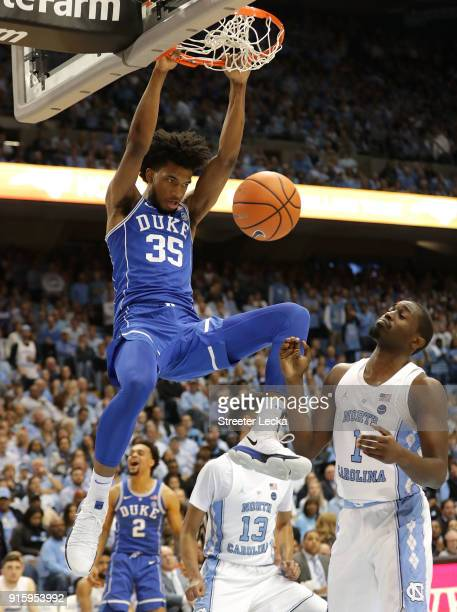 Theo Pinson of the North Carolina Tar Heels watches as Marvin Bagley III of the Duke Blue Devils dunks the ball during their game at Dean Smith...