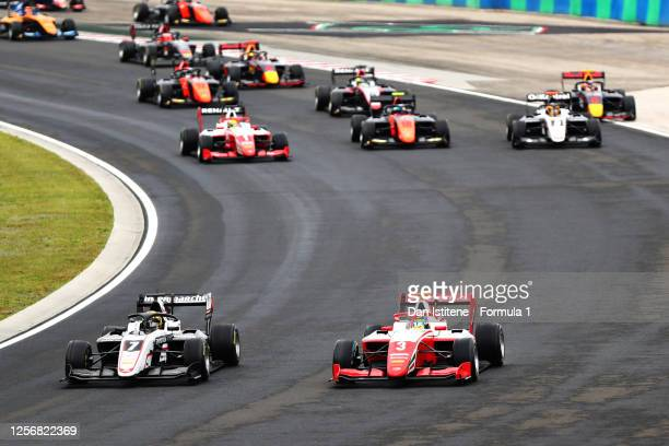 Theo Pourchaire of France and ART Grand Prix leads Logan Sargeant of United States and Prema Racing and the rest of the field at the start during...