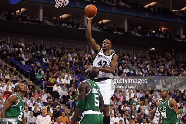 Theo Ratliff of Minnesota Timberwolves shots between Ray Allen Kevin Garnett and Paul Pierce of Boston Celtics in the O2 Arena in London during NBA...
