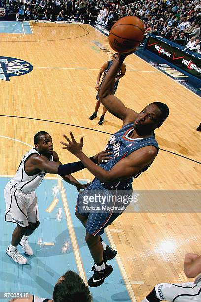 Theo Ratliff of the Charlotte Bobcats goes up for the shot over Paul Millsap of the Utah Jazz at EnergySolutions Arena on February 24, 2010 in Salt...