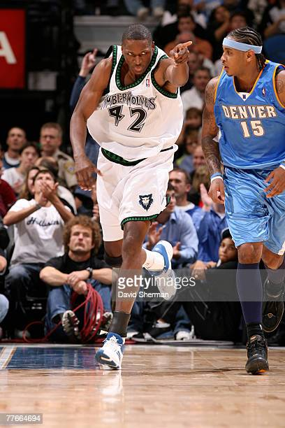 Theo Ratliff of the Minnesota Timberwolves runs up the court against Carmelo Anthony of the Denver Nuggets on November 2 2007 at the Target Center in...