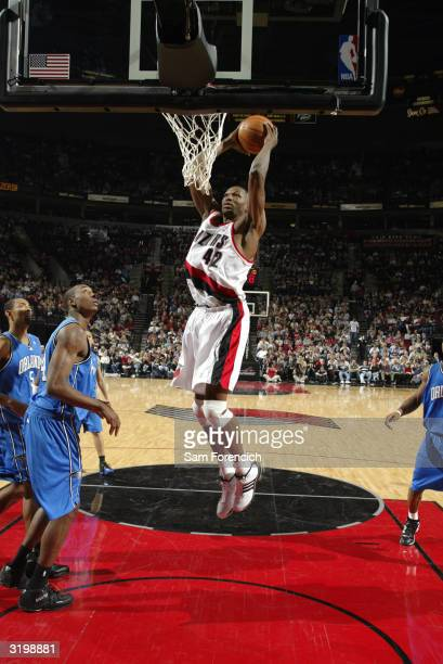 Theo Ratliff of the Portland Trail Blazers dunks the ball during the game against the Orlando Magic at the Rose Garden on March 20 2004 in Portland...