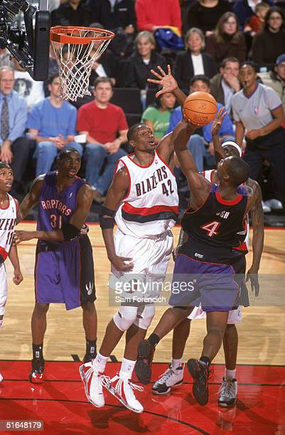 Theo Ratliff of the Portland Trail Blazers goes up to block a shot by Chris Bosh of the Toronto Raptors during a preseason game at The Rose Garden on...