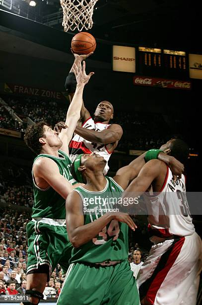 Theo Ratliff of the Portland Trail Blazers jumps to the basket against Raef LaFrentz and Paul Pierce of the Boston Celtics during a game on December...