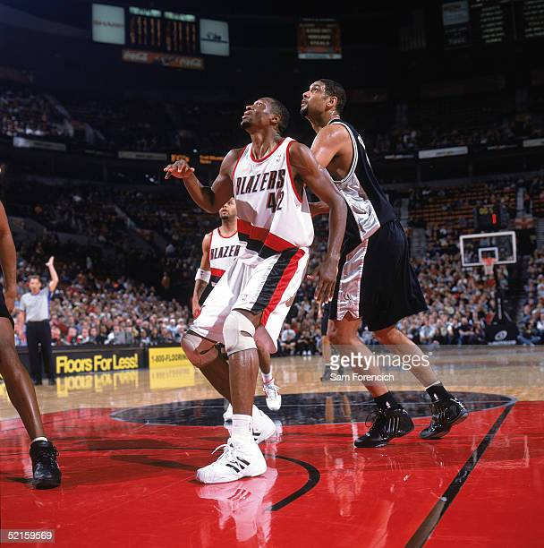 Theo Ratliff of the Portland Trail Blazers looks for the rebound with Tim Duncan of the San Antonio Spurs at Rose Garden on January 24 2005 in...
