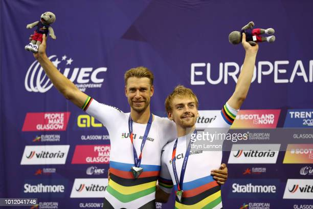 Theo Reinhardt of Germany and Roger Kluge of Germany celebrate winning a silver medal in the Men's Madison final during the track cycling on Day five...