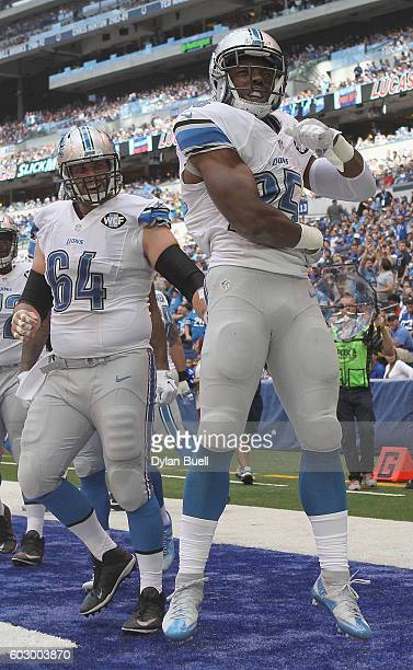 Theo Riddick of the Detroit Lions and Travis Swanson of the Detroit Lions celebrate after a Detroit touchdown in the second quarter against the...