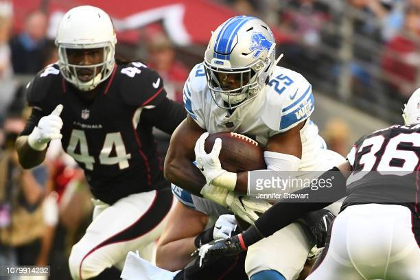 Theo Riddick of the Detroit Lions carries in the first half of the NFL game against the Arizona Cardinals at State Farm Stadium on December 09 2018...