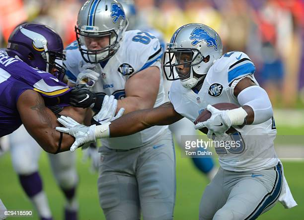 Theo Riddick of the Detroit Lions carries the ball during an NFL game against the Minnesota Vikings at US Bank Stadium November 6 2016 in Minneapolis...
