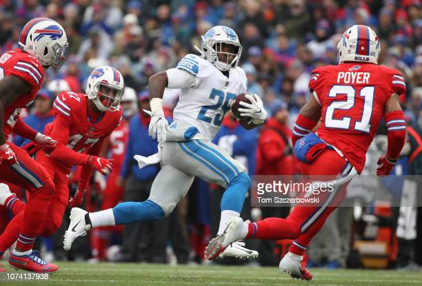 Theo Riddick of the Detroit Lions carries the ball in the second quarter during NFL game against the Buffalo Bills at New Era Field on December 16...