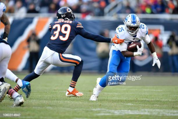 Theo Riddick of the Detroit Lions carries the football against Eddie Jackson of the Chicago Bears in the fourth quarter at Soldier Field on November...