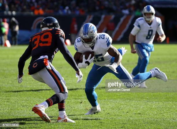 Theo Riddick of the Detroit Lions carries the football against Eddie Jackson of the Chicago Bears in the second quarter at Soldier Field on November...