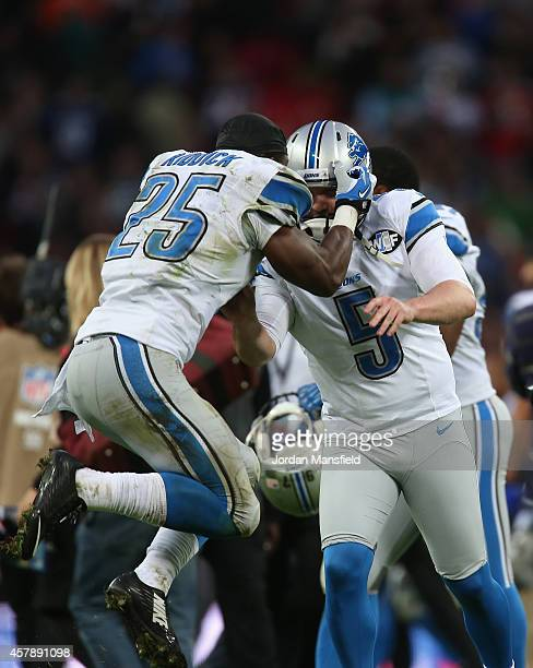 Theo Riddick of the Detroit Lions celebrates with Matt Prater of the Detroit Lions after he scored the winning field goal during the NFL match...