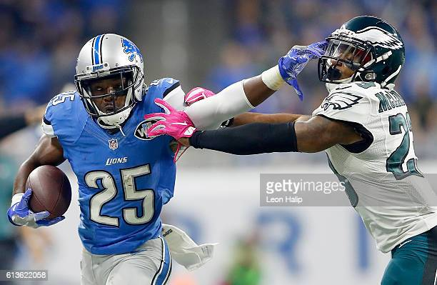 Theo Riddick of the Detroit Lions gives a stiff arm to Rodney McLeod of the Philadelphia Eagles during first half action at Ford Field on October 9...