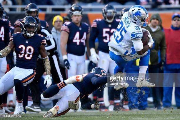 Theo Riddick of the Detroit Lions is hit by Danny Trevathan of the Chicago Bears in the fourth quarter at Soldier Field on November 11 2018 in...